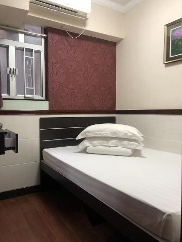 A bed or beds in a room at Hang Fung Hostel