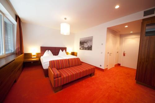 Ein Bett oder Betten in einem Zimmer der Unterkunft Business Hotel Ambio Gleisdorf