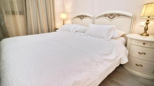 A bed or beds in a room at Hotel Bellevue Trogir