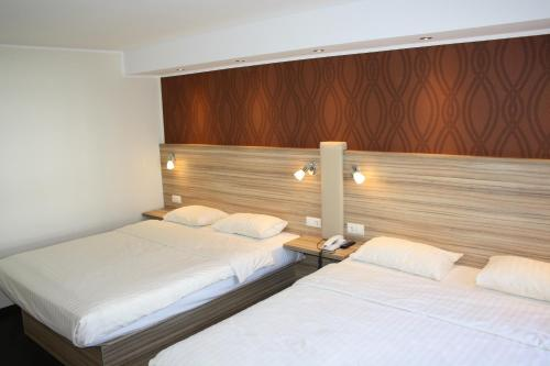 A bed or beds in a room at Star Inn Hotel Regensburg Zentrum, by Comfort