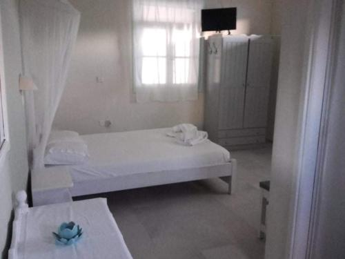 A bed or beds in a room at Villa Studios