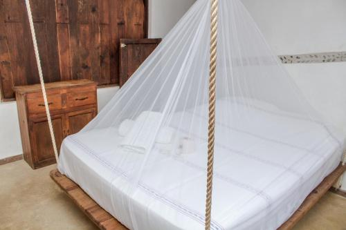 A bed or beds in a room at Cabañas Biuzaa
