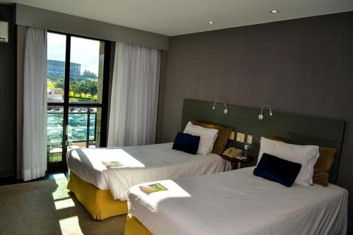 Cama ou camas em um quarto em Grand Mercure Brasilia Eixo Monumental