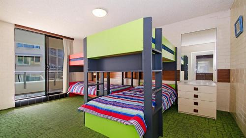 A bunk bed or bunk beds in a room at By The Sea Unit 4, 13 Esplanade, Kings Beach
