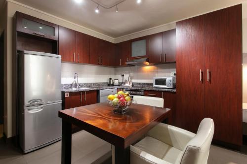 Кухня или мини-кухня в Absolute Farenden Apartments