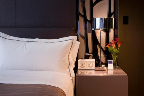 A bed or beds in a room at W Atlanta Downtown
