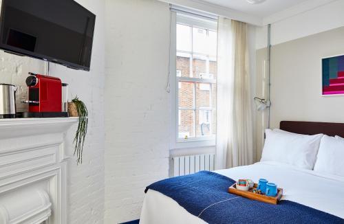 Un ou plusieurs lits dans un hébergement de l'établissement The Buxton