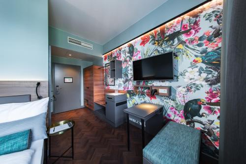 A television and/or entertainment center at Maison Schiller by DesignCity Hotels