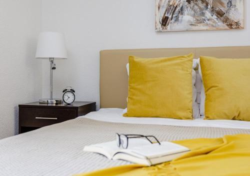 Ένα ή περισσότερα κρεβάτια σε δωμάτιο στο Swiss Star Anwand Lodges - contactless self check-in