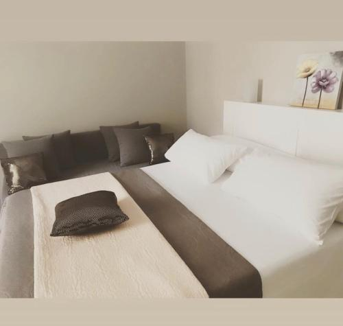 A bed or beds in a room at Junior Suite