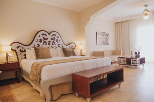 A bed or beds in a room at Majestic Colonial Punta Cana - All Inclusive