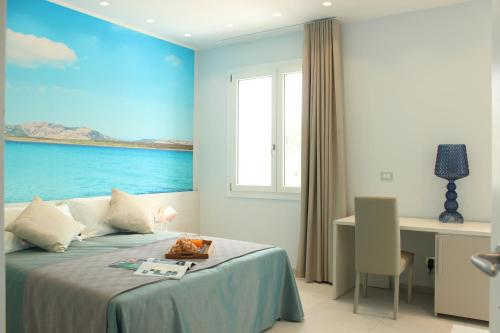 A bed or beds in a room at 103 Boutique Hotel Stintino