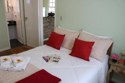 A bed or beds in a room at Biz & Biu Pousada Lavras Novas