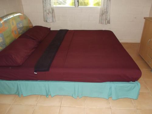 A bed or beds in a room at Green Lodge Holiday Homes