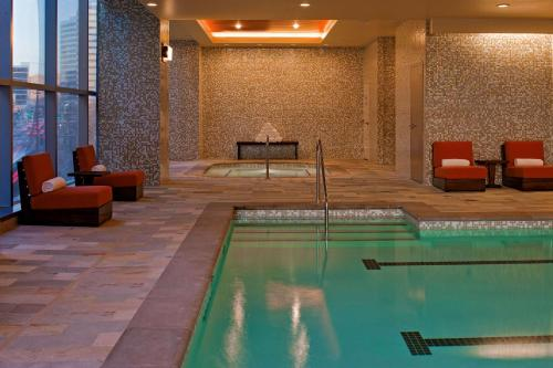 The swimming pool at or near Hyatt at Olive 8