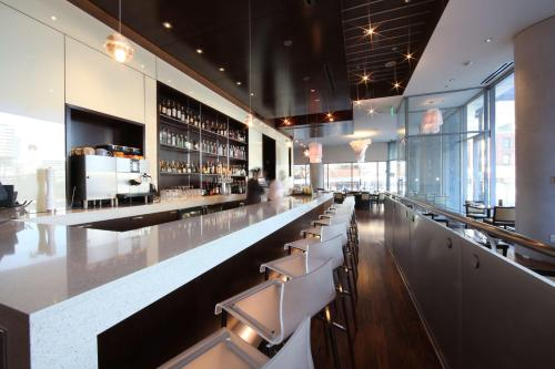 The lounge or bar area at Hyatt at Olive 8