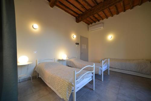 Katil atau katil-katil dalam bilik di Ostello Palazzo Nizza