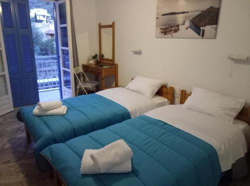 Ένα ή περισσότερα κρεβάτια σε δωμάτιο στο Panos Studios