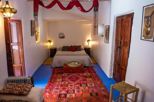 A bed or beds in a room at Maison d'hotes Berbari