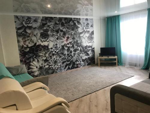 Телевизор и/или развлекательный центр в Апартаменты на Ускова