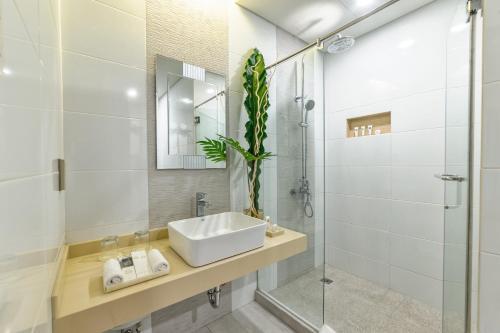 Un baño de Sweet Home Boutique Hotel