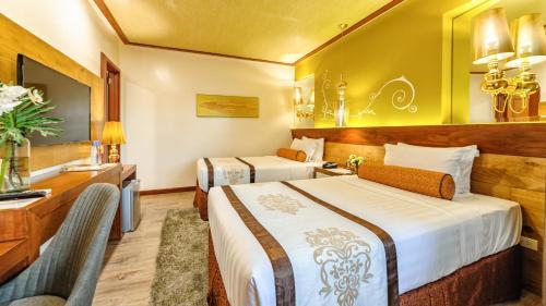Cama o camas de una habitación en Sweet Home Boutique Hotel