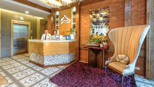 El vestíbulo o zona de recepción de Sweet Home Boutique Hotel