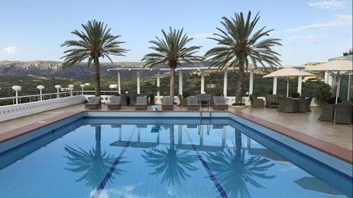 The swimming pool at or near Castri Village Hotel