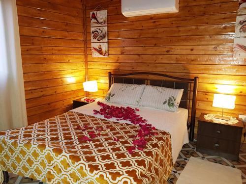 Letto o letti in una camera di Wooden house in Eilat
