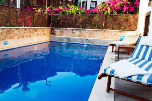 The swimming pool at or near Deja Vu Hotel