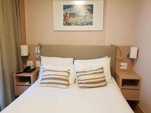Cama ou camas em um quarto em Flat Premium - Luxo & Conforto
