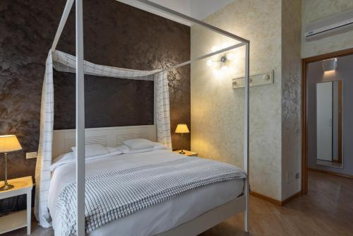 A bed or beds in a room at Hotel Mastino