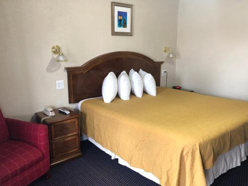 A bed or beds in a room at Knights Inn Harrisonville
