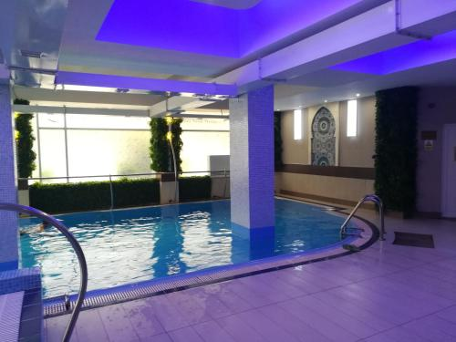 The swimming pool at or near Hotel Nevis Wellness & SPA