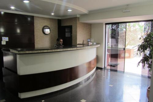 The lobby or reception area at Golden Suíte Hotel