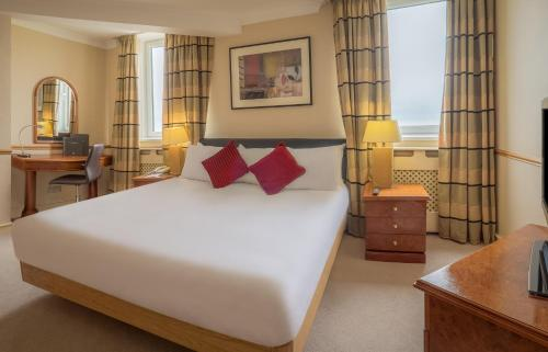 A bed or beds in a room at Grand Hotel Blackpool
