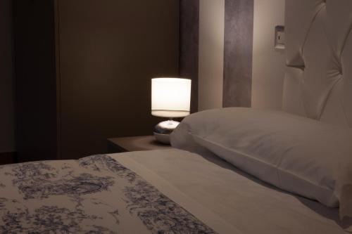 Ліжко або ліжка в номері Appartamenti Museo