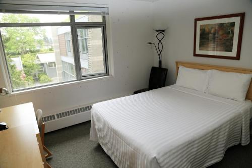 A bed or beds in a room at Carey Centre