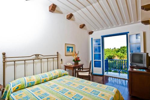 Cama ou camas em um quarto em Sauipe Pousadas - All Inclusive