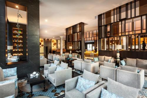 El salón o zona de bar de Hotel Riu Palace Oasis