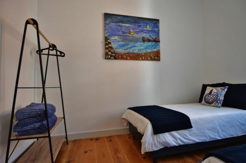 A bed or beds in a room at Casa Joana B&B