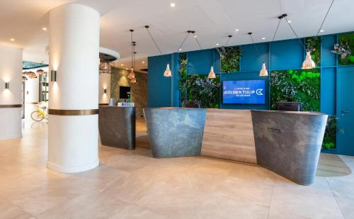 The lobby or reception area at Golden Tulip Aix les Bains - Hotel & Spa