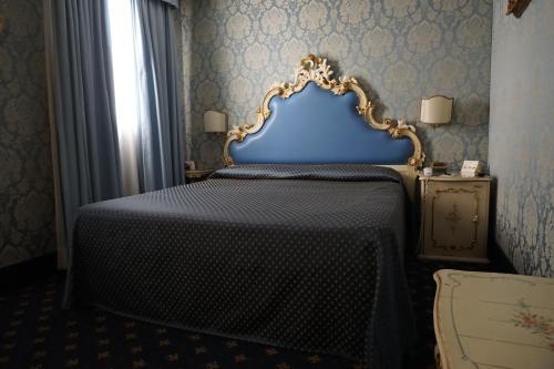 Cama ou camas em um quarto em Hotel Rialto