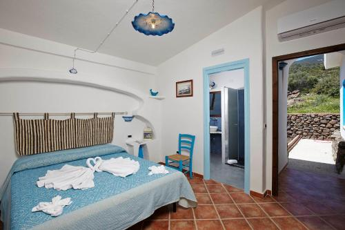 A bed or beds in a room at Agriturismo Codula Fuili