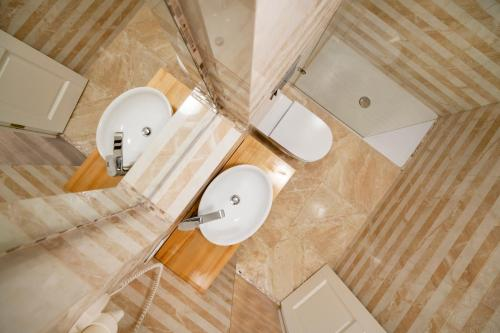 A bathroom at Vilnius Apartments