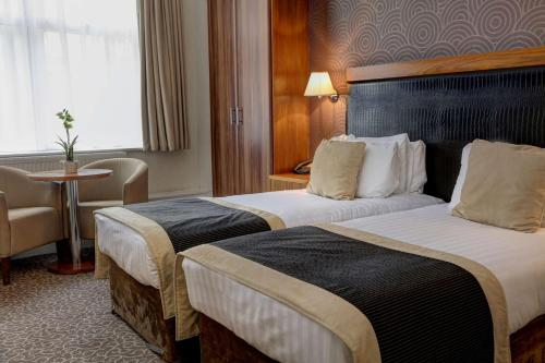 A bed or beds in a room at The Midland Hotel, Sure Hotel Collection by Best Western