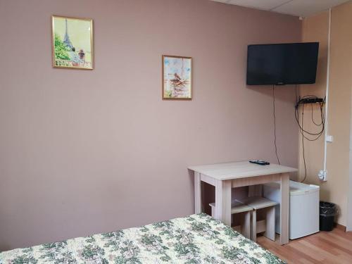 Телевизор и/или развлекательный центр в Мини Отель на Чкалова