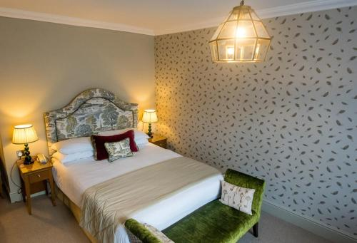 A bed or beds in a room at The Maids Head Hotel