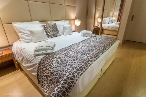 A bed or beds in a room at Millenium Suites