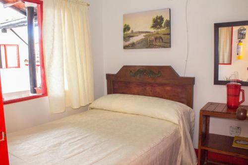 A bed or beds in a room at Hotel La Casona